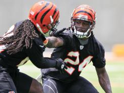 Cincinnati Bengals cornerback Adam Jones (24) pushes off safety Reggie Nelson during a recent practice in Cincinnati on July 12.