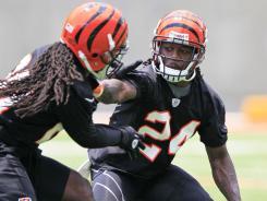 Cincinnati Bengals cornerback Adam Jones (24) pushes off safety Reggie Nelson during a recent practice in Cincinnati on July 12.