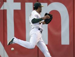 A's center fielder Coco Crisp can't make the catch on an RBI double by the Yankees' Robnson Cano during May 25 game in Oakland. The play was initially ruled an error on Crisp.