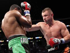 Tomasz Adamek, right, and Eddie Chambers trade punches during their 12-round IBF North American Heavyweight title bout.