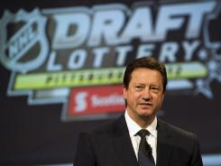 Steve Tambellini's Edmonton Oilers have a tough choice after winning the draft lottery again.