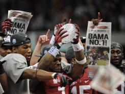 Members of the Alabama Crimson Tide celebrate their 21-0 victory over LSU in the BCS championship game on Jan. 9.
