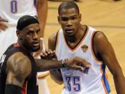 Heat forward LeBron James, left, and Thunder forward Kevin Durant are living up to the pre-Finals hype.