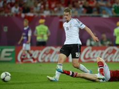 German midfielder Lars Bender, left, scores in the 80th minute during Sunday's Euro 2012 match against Denmark.