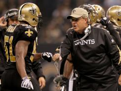 Former Saints defensive coordinator Gregg Williams celebrates a play with linebacker Jonathan Vilma (51) against the Carolina Panthers during the 2009 season.