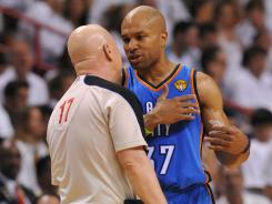 Oklahoma City point guard Derek Fisher discusses a call with official Joe Crawford during the second quarter in Game 3 Sunday at the American Airlines Arena.