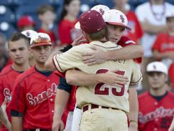Florida State's James Ramsey hugs Stony Brooks' Tyler Johnson after the Seminoles eliminated the Seawolves from the College World Series.