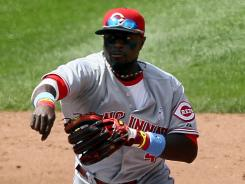 Reds second baseman Brandon Phillips completes a double play in the fifth inning against sliding Omar Quintanilla and the Mets. In the sixth, he used a between the legs flip to start another double play.