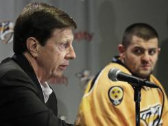 Nashville Predators general manager David Poile, left, persuaded Alexander Radulov to return from Russia but now has cut ties with the player after he broke curfew during the playoffs.