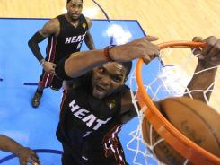 Miami forward Chris Bosh, dunking the ball, has to be aggressive on offensive rebounds to give the Heat an edge on the Oklahoma City Thunder in the NBA Finals.