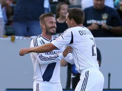 Todd Dunivant, right, celebrates his goal with teammate David Beckham in the second half of their match against the Timbers. Dunivant scored the lone goal to help the Galaxy snap a seven-game winless streak.