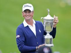 Webb Simpson of the USA celebrates with the trophy after his one-stroke victory in the 112th U.S. Open at The Olympic Club on Sunday.