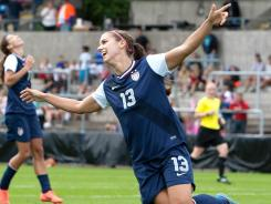 Alex Morgan celebrates her goal during the Swedish Invitational Women's Volvo Cup match between Japan and the USA on Monday in Halmstad, Sweden.