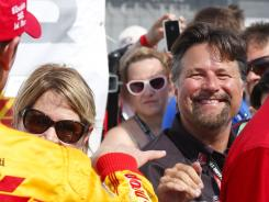 Team owner Michael Andretti, right, smiles at Ryan Hunter-Reay, who won Saturday's IndyCar race at the Milwaukee Mile in West Allis, Wis.