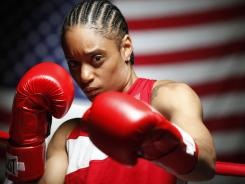 Underwood won the first U.S. Olympic boxing team trials in February, but dropped a one-point decision at the world championships last month, falling just short of Olympic qualification and jeopardizing her berth in London's 12-fighter lightweight field. USA Boxing says Underwood received an Olympic spot from AIBA, the international governing body of amateur boxing.