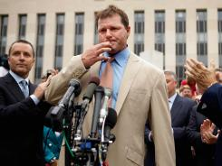 Cleared on all counts: Roger Clemens, flanked by lawyers Michael Attanasio, left, and Rusty Hardin, speaks outside a court in Washington after being acquitted on six counts in his federal perjury trial.