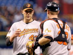 Orioles closer Jim Johnson -- left, with catcher Matt Wieters -- has a 1.21 ERA and 0.67 WHIP this season and is second in the majors with 20 saves.