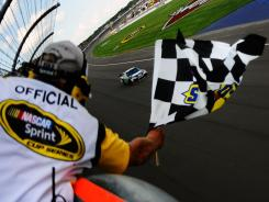 Dale Earnhardt Jr. takes his first checkered flag in four years Sunday at Michigan International Speedway.