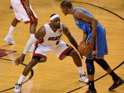 Heat forward LeBron James guards scoring champ Kevin Durant of the Thunder on Sunday in Game 3 of the NBA Finals.