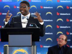 LaDainian Tomlinson speaks during his retirement press conference as San Diego Chargers president Dean Spanos looks on at Charger Park.