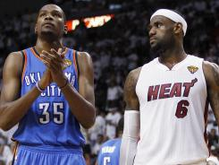 Oklahoma City Thunder forward Kevin Durant (35) and Miami Heat small forward LeBron James (6) go to their positions during the second half at Game 3.