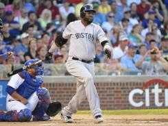 Boston Red Sox first baseman David Ortiz hits an RBI single against the Chicago Cubs during the first inning at Wrigley Field.