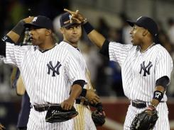 From left, Yankees' DeWayne Wise, Derek Jeter and Curtis Granderson celebrate another win in June.