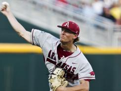 Arkansas starting pitcher Ryne Stanek works against South Carolina in the first inning of an NCAA College World Series baseball game in Omaha, Neb., on Monday.