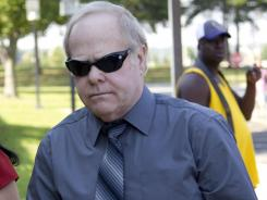 Harvey Updyke arrives Tuesday at the Lee County Justice Center in Auburn, Ala., with jury selection is scheduled to begin in his trial.