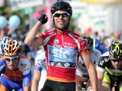 Britain's Mark Cavendish celebrates after winning the 13th stage of the Tour of Italy on May 18. Cavendish will race for a second consecutive Tour de France green jersey but expects to be less dominant in the sprints after changing his training regimen and losing weight for the Olympics.