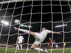 England defender John Terry tries to clear Marko Devic's shot off the goal line in the 62nd minute. No goal was awarded though replays showed that the ball crossed the line.