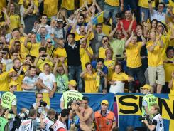 Sweden's Zlatan Ibrahimovic celebrates with fans after the 2-0 victory. The Swedish captain kicked off the scoring with a stunning volley that beat French goalkeeper Hugo Lloris.