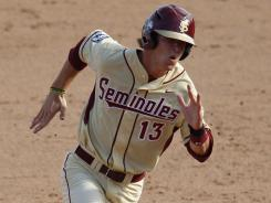 Florida State's John Holland is hitting .243 this season as a freshman.
