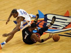 Oklahoma City Thunder forward Serge Ibaka, left, and Miami Heat forward Chris Bosh, right, have tangled on the court — and off the court, in defense of his team's star, OKC's Kevin Durant and Miami's LeBron James.