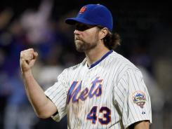 R.A. Dickey celebrates after pitching a complete game one-hitter against the Orioles on Monday.