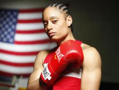 Queen Underwood, 27, of Seattle has been awarded a berth into the lightweight division for the London Games.