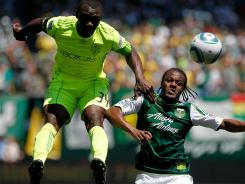 Jhon Kennedy Hurtado of the Seattle Sounders battles Jorge Perlaza of the Portland Timbers on July 10, 2011 at Jeld-Wen Field in Portland.