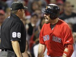 He's outta there: The Red Sox's Kevin Youkilis, right, was ejected by umpire Doug Eddings after arguing a called third strike June 8, adding another chapter to a disappointing season.