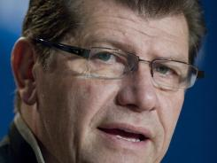 In this file photo taken March 18, 2012, Connecticut head coach Geno Auriemma speaks during an NCAA women's college basketball news conference in Bridgeport, Conn. A woman who works as an NBA security official has filed an employment discrimination lawsuit saying she was removed from an assignment to the London Olympics after she spurned an advance from Auriemma, coach of the U.S. women's team.