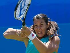 Marion Bartoli of France fires one of her double-fisted strokes in her victory Wednesday against Aleksandra Wozniak of Canada.