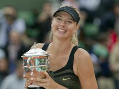 Maria Sharapova of Russia is among those who are excited for the Olympic tennis tournament at Wimbledon. She'll try to complete a Golden Grand Slam.