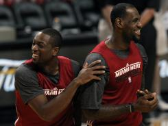 Dwyane Wade, left, and LeBron James are relaxed and confident heading into Game 5.