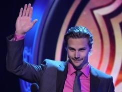 Erik Karlsson of the Ottawa Senators acknowledges the cheers after winning the Norris Trophy on Wednesday during the 2012 NHL Awards in Las Vegas.