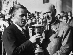 This 1930 photo shows Bobby Jones, left, being presented with the U.S. Amateur Golf Championship trophy by USGA President Findlay Douglas at the Merion Cricket Club in Ardmore, Pa. Merion Golf Club has challenged legions of golfers and claims Jones, Hogan and Nicklaus among its champions.