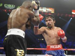 Pacquiao, right, says he now wants a rematch with Timothy Bradley, left.