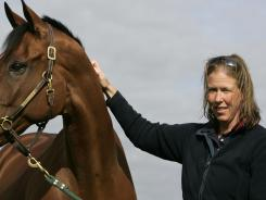 This July 21, 2008 file photo shows Olympic equestrian Amy Tryon with her horse Poggio II at a farm near Cherington, England.