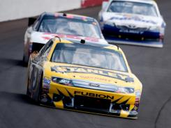 Marcos Ambrose runs first, ahead of Greg Biffle and Mark Martin, at Sunday's Quicken Loans 400 at Michigan International Speedway. Ambrose finished ninth, tying his best of the 2012 season.