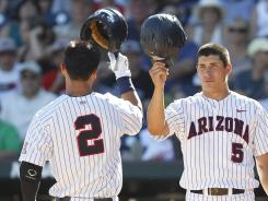 Arizona's Robert Refsnyder (2) celebrates his home run with Seth Mejias-Brean (5) against Florida State on Thursday.