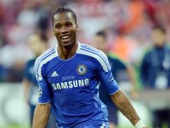 Didier Drogba celebrates after scoring an 88th-minute equalizer in the 2012 UEFA Champions League Final. Chelsea went on to win in penalty kicks. Drogba, joining Shanghai Shenhua, will reportedly be the highest-paid player in China.