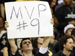 New Orleans Saints fans cheer on Drew Brees against the Atlanta Falcons during the fourth quarter at the Mercedes-Benz Superdome. The Saints defeated the Falcon 45-16. Brees broke the NFL single-season passing record formerly held by Miami Dolphins quarterback Dan Marino.